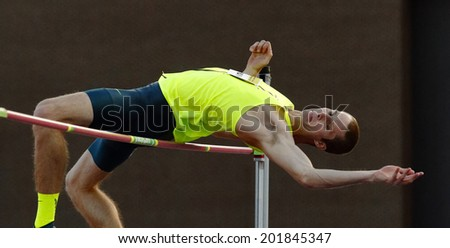 MONCTON, CANADA - June 28: Derek Drouin competes in the men's high jump at the Canadian Track & Field Championships June 28, 2014 in Moncton, Canada. - stock photo