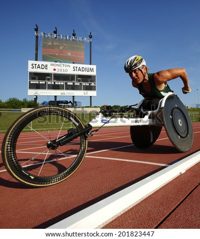 MONCTON, CANADA - June 28: Diane Roy races in the women's 1500-metre wheelchair at the Canadian Track & Field Championships June 28, 2014 in Moncton, Canada. - stock photo