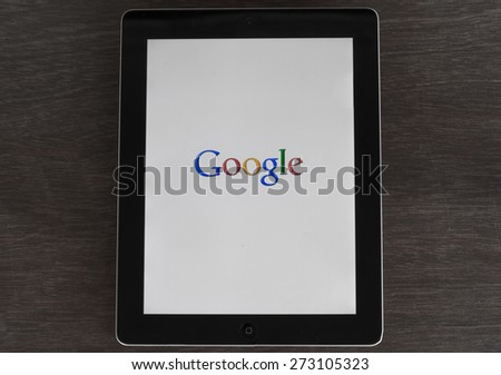 Monday, 27 April 2015: in Chiang mai Thailand Google search icon on ipad on Black and White wood table. - stock photo