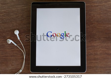 Monday, 27 April 2015: in Chiang mai Thailand Google search icon on ipad on wood table. - stock photo