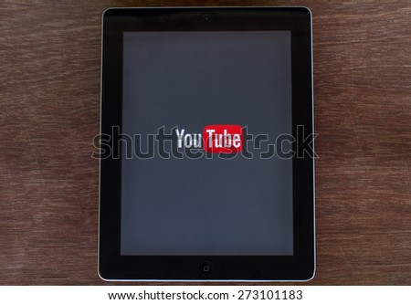 Monday, 27 April 2015: in Chiang mai Thailand ,Youtube icon on ipad on wood table. - stock photo