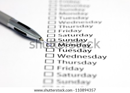 Monday checked in check box in a row of days of the week - stock photo