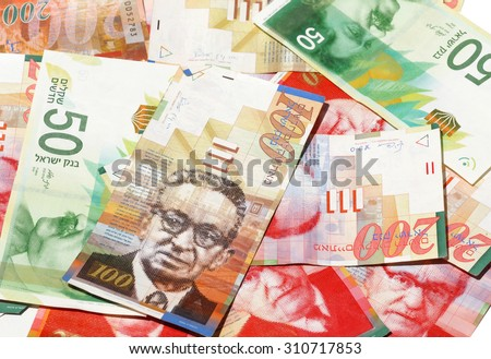 Money - A pile of New Israeli Shekels banknotes (NIS). Selective focus - stock photo