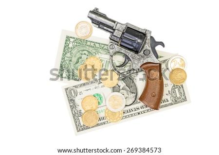 Money and a gun white background - stock photo