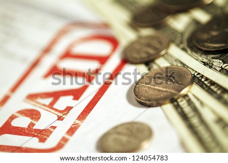 Money and a Receipt . Very shallow focus. - stock photo