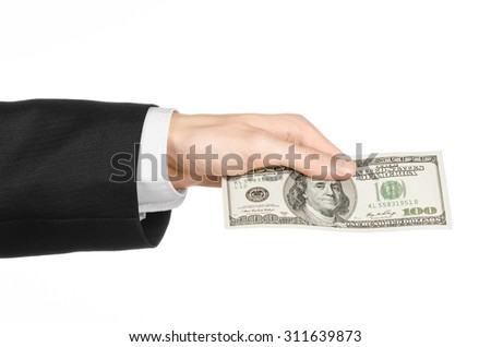 Money and business topic: hand in a black suit holding dollars banknotes isolated on white background in studio - stock photo
