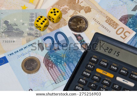 Money and calculator and dice  in year 2015 - stock photo