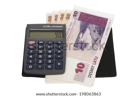 Money and calculator isolated on white background - stock photo