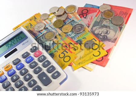 money and calculator on isolate background - stock photo