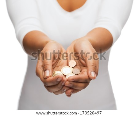 money and finances concept - close up of womans cupped hands showing euro coins - stock photo