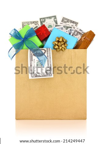 Money and gifts in a paper bag on white background - stock photo