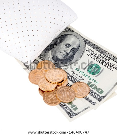 Money and gold tucked away under a pillow during financial crisis. - stock photo