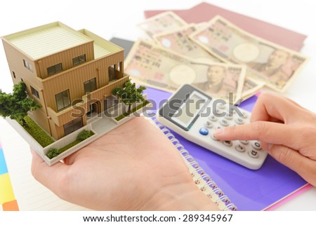 Money and house model - stock photo