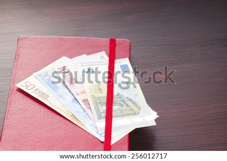 money and notebook - stock photo