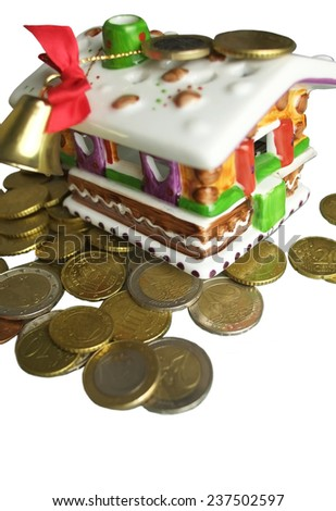 Money around a Christmas House, close up isolated on white,  finance concept - stock photo