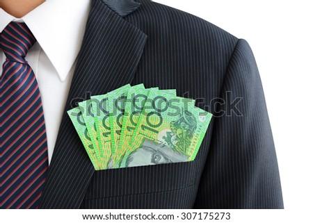 Money,Australian dollar (AUD) banknotes, in businessman suit pocket - stock photo