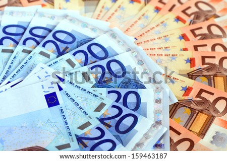 Money background. Extreme closeup of European Union currency - stock photo