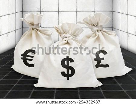 Money Bags in concrete room - stock photo