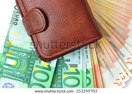 Money banknotes (euro) and wallet (purse) background - stock photo