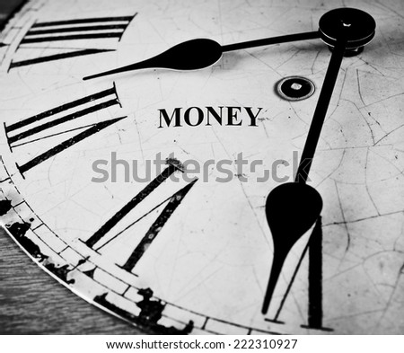 Money black and white clock face, money running out concept. - stock photo