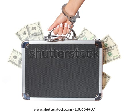 money, case of dollars bills in female hand with handcuffs, isolated on white. concert - stock photo
