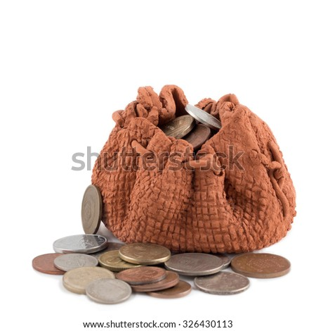 Money clay bag and coins isolated on a white background.  Investment or growth concept - stock photo