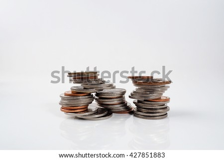Money coins on white background with copy space. - stock photo