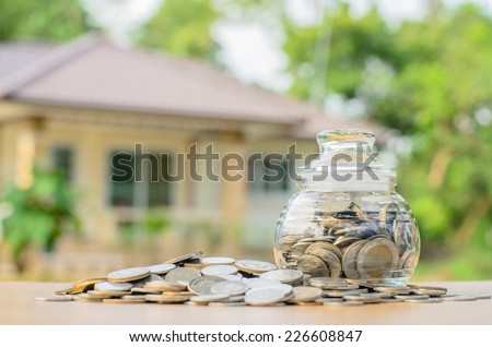 money coins with home, Saving for buy home concept - stock photo