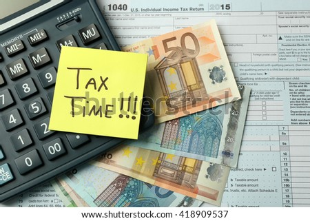 Money concept. Black calculator with cash and documents, close up - stock photo