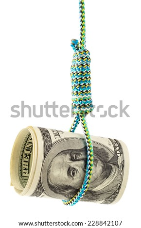 Money debt and credit. Rolled dollars in a noose depicting tough economic times, devaluation, recession and financial collapse.   - stock photo