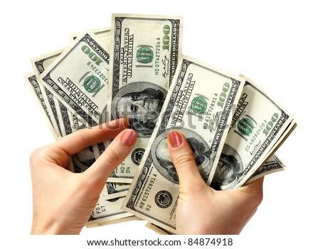 Money dollar in hand. Isolated. - stock photo
