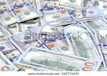 money dollars currency cash banknotes on a white background - stock photo