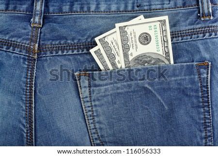 money dollars in jeans back pocket  blue color background - stock photo