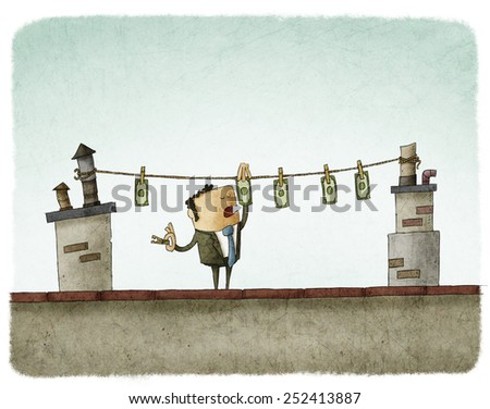 Money drying on the rooftop - stock photo
