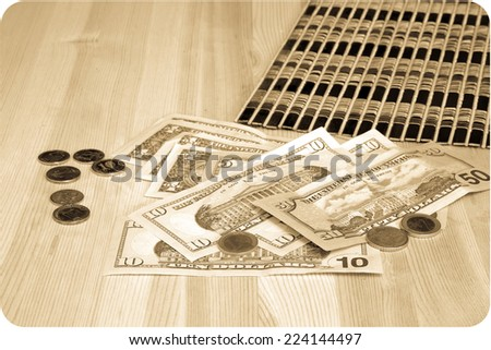 Money euro and dollars, coins and banknotes. On a wooden table - stock photo