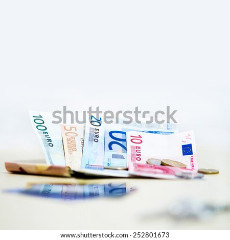 Money euro coins and banknotes on white background in square - stock photo