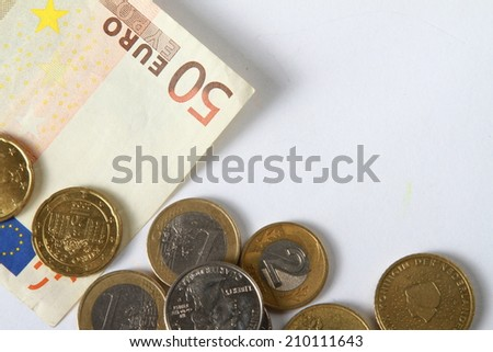 Money euro coins and bills close up isolated on white - stock photo