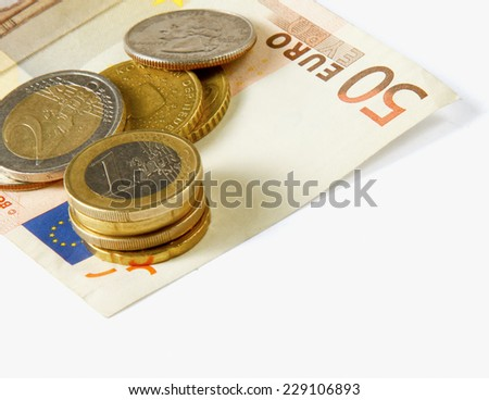 Money: euro coins and bills close up isolated on white background - stock photo