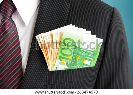 Money, Euro currency(EUR) bills, in businessman suit pocket - stock photo
