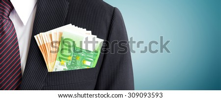 Money, Euro currency (EUR), in businessman suit pocket - business and financial panoramic header background - stock photo