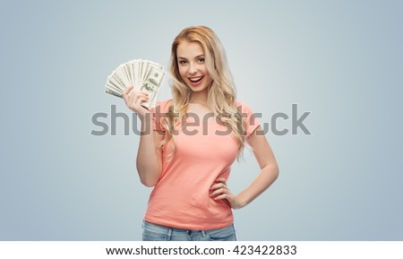 money, finances, investment, saving and people concept - happy young woman with dollar cash money over gray background - stock photo