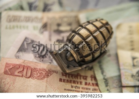 Money for War Concept Hand Grenade or pineapple and Money bill from different countries  - stock photo