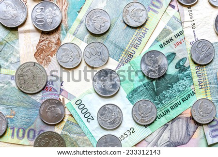 Money from Indonesia, rupiah banknotes and coins. - stock photo