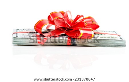 Money gift, big stack of dollars with red bow isolated on white background  - stock photo