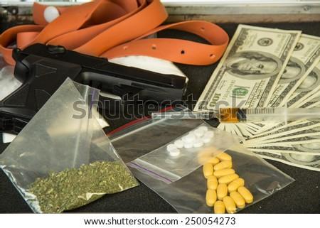 Money, gun and drugs closeup - stock photo