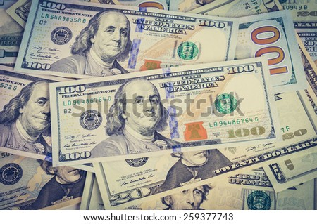 Money - heap of US dollar bills in vintage (retro) style color effect - stock photo