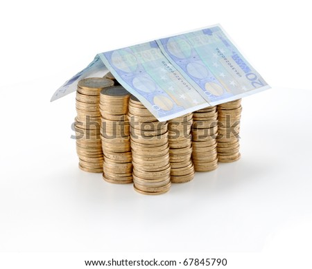 Money house made from lots of coins and euro banknote roof - isolated with reflection - stock photo