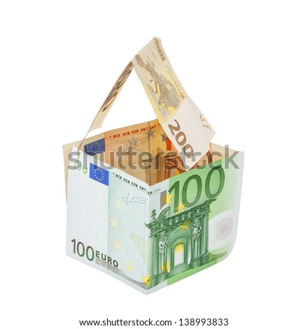 Money house made of euro money concept symbol of wealth. On a white background. - stock photo