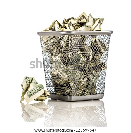 Money in a basket on a white background - stock photo