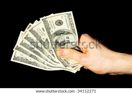 Money in a hand on a black background. (isolated) - stock photo